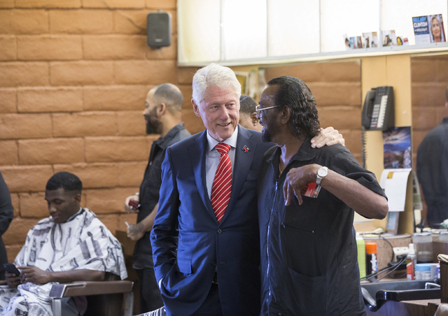 Former President Bill Clinton shakes hands with Mac Smith, Jr., owner of Hair Unlimited, on Thursday, Nov. 3, 2016, in Las Vegas. President Clinton was in Las Vegas for a rally at Cox Pavilion for ...