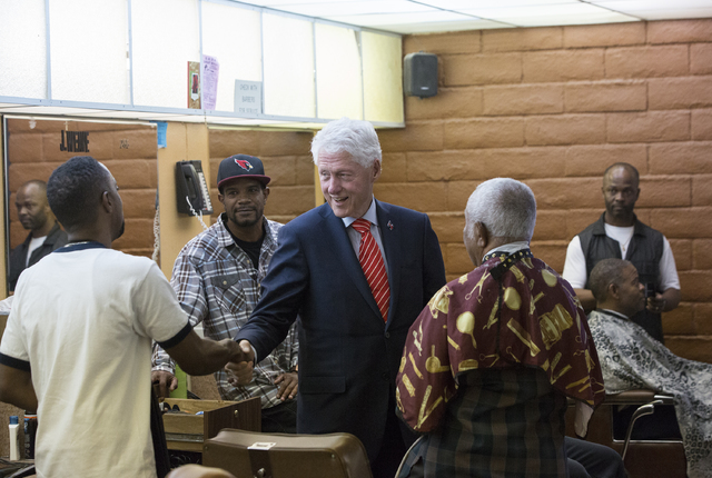 Former President Bill Clinton shakes hands with supporters at Hair Unlimited on Thursday, Nov. 3, 2016, in Las Vegas. President Clinton was in Las Vegas for a rally at Cox Pavilion for his wife, D ...