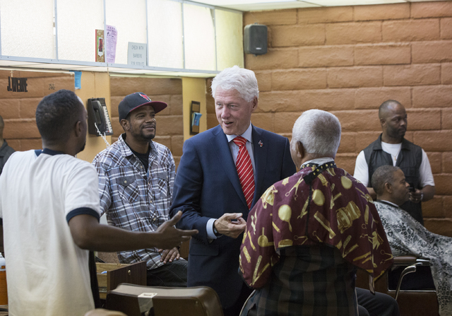 Former President Bill Clinton interacts with patrons at Hair Unlimited on Thursday, Nov. 3, 2016, in Las Vegas. President Clinton was in Las Vegas for a rally at Cox Pavilion for his wife, Democra ...