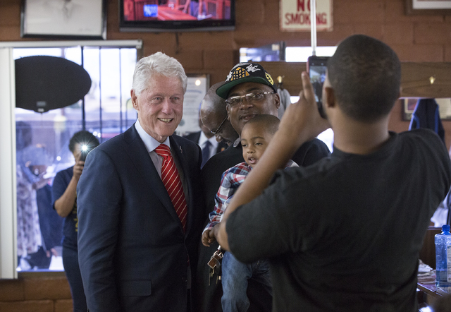 Former President Bill Clinton takes photos with supporters at Hair Unlimited on Thursday, Nov. 3, 2016, in Las Vegas. President Clinton was in Las Vegas for a rally at Cox Pavilion for his wife, D ...