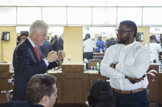 Former President Bill Clinton jokes around with Sean Tory at Hair Unlimited on Thursday, Nov. 3, 2016, in Las Vegas. President Clinton was in Las Vegas for a rally at Cox Pavilion for his wife, De ...