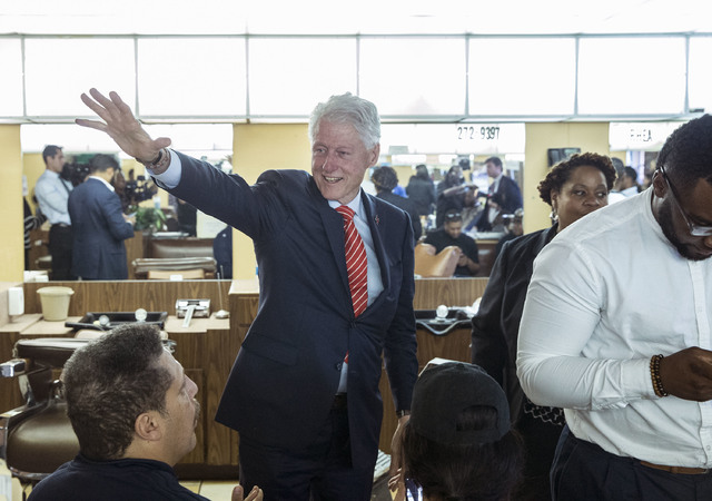 Former President Bill Clinton waves to patrons at Hair Unlimited on Thursday, Nov. 3, 2016, in Las Vegas. President Clinton was in Las Vegas for a rally at Cox Pavilion for his wife, Democratic pr ...