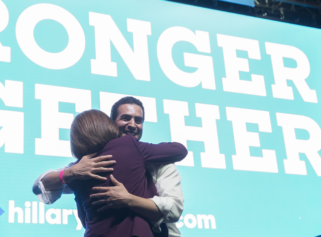 U.S. Senate candidate Catherine Cortez Masto, left, hugs State Senator Ruben Kihuen, D-Nevada, at a rally for Democratic presidential nominee Hillary Clinton at Cox Pavilion on Thursday, Nov. 3, 2 ...