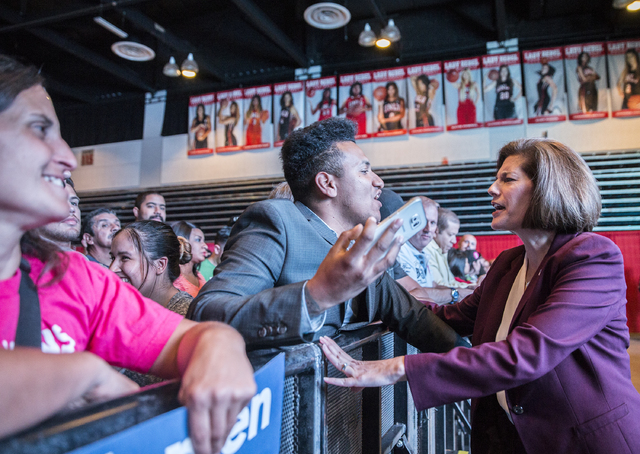 U.S. Senate candidate Catherine Cortez Masto interacts with supporters at a rally for Democratic presidential nominee Hillary Clinton at Cox Pavilion on Thursday, Nov. 3, 2016, at UNLV, in Las Veg ...