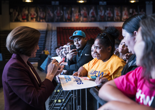 U.S. Senate candidate Catherine Cortez Masto, left, talks with Teaera Garner at a rally for Democratic presidential nominee Hillary Clinton at Cox Pavilion on Thursday, Nov. 3, 2016, at UNLV, in L ...