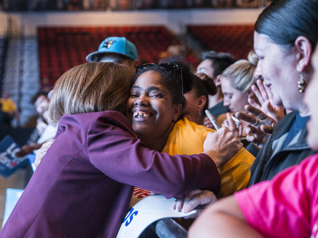 U.S. Senate candidate Catherine Cortez Masto, left, gets a hug from Teaera Garner at a rally for Democratic presidential nominee Hillary Clinton at Cox Pavilion on Thursday, Nov. 3, 2016, at UNLV, ...