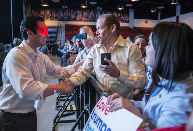State Senator Ruben Kihuen, D-Nevada, left, shakes hands with Gig Schmidt at a rally for Democratic presidential nominee Hillary Clinton at Cox Pavilion on Thursday, Nov. 3, 2016, at UNLV, in Las  ...