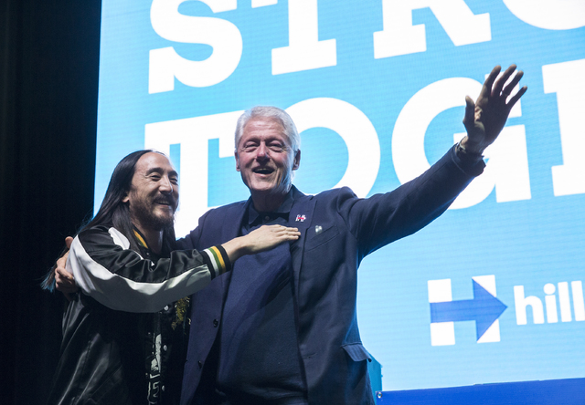Former President Bill Clinton, right, and musician/philanthropist Steve Aoki interact with the crowd at a rally at Cox Pavilion on Thursday, Nov. 3, 2016, at UNLV, in Las Vegas. The event was a ca ...