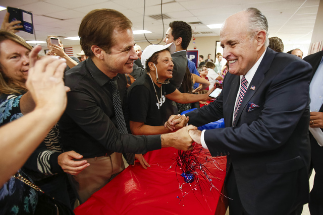 Lawyer and former New York City Mayor Rudy Giuliani greets a fan after speaking to supporters of Republican presidential candidate Donald Trump during a campaign rally at the Trump-Pence Nevada ca ...