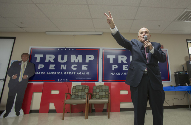 Lawyer and former New York City Mayor Rudy Giuliani speaks to supporters of Republican presidential candidate Donald Trump during a campaign rally at the Trump-Pence Nevada campaign headquarters i ...
