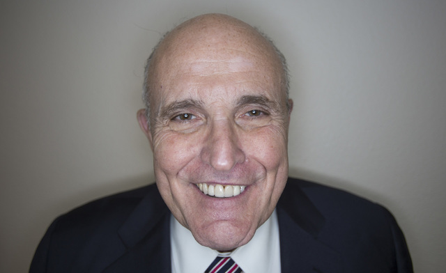 Lawyer and former New York City Mayor Rudy Giuliani poses for a photo in Las Vegas, Sunday, Nov. 6, 2016. Giuliani was in Las Vegas campaigning for Republican presidential candidate Donald Trump.  ...