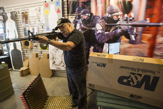Las Vegas resident Al Wooten, 67, tries out his new Smith & Wesson rifle at Westside Armory, a gun and ammo store, located at 7345 S. Durango Drive in Las Vegas on Tuesday, Oct. 18, 2016. Rich ...