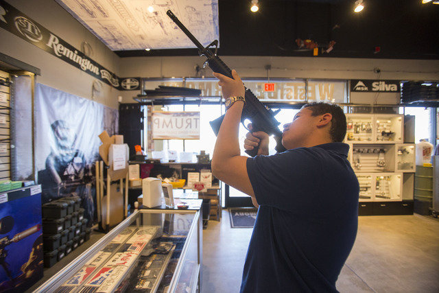 Las Vegas resident Dillion Ford, 21, browses the rifles at Westside Armory, a gun and ammo store, located at 7345 S. Durango Drive in Las Vegas on Tuesday, Oct. 18, 2016. Richard Brian/Las Vegas R ...
