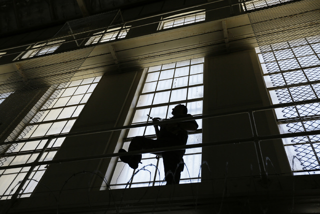 A guard keeps watch on the east block of death row at San Quentin State Prison in San Quentin, Calif. (AP Photo/Eric Risberg)