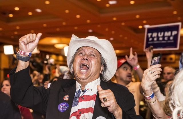 Eddie Hamilton cheers as Republican presidential nominee Donald Trump is officially announced as the 45th President of the United States at an election night event hosted by the Nevada Republican  ...
