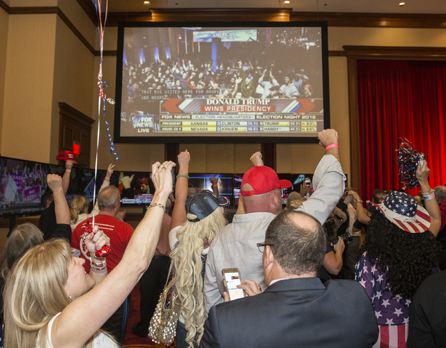 Supporters cheers as Republican presidential nominee Donald Trump is officially announced as the 45th President of the United States at an election night event hosted by the Nevada Republican Part ...