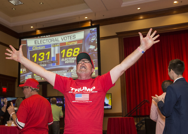 Trump supporter Dane Senser cheers as initial results are announced at an election night event hosted by the Nevada Republican Party at South Point hotel-casino on Tues, Nov. 8, 2016, in Las Vegas ...