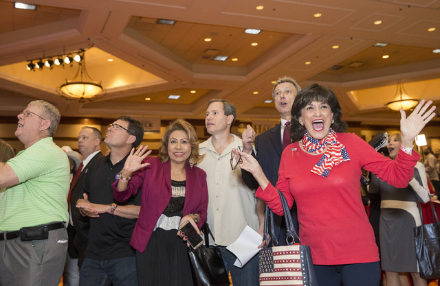 Trump supporter Aleyda Hernandez, right, cheers as initial  results are announced at an election night event hosted by the Nevada Republican Party at South Point hotel-casino on Tues, Nov. 8, 2016 ...