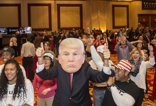 Trump supporters cheer as initial results are announced at an election night event hosted by the Nevada Republican Party at South Point hotel-casino on Tues, Nov. 8, 2016, in Las Vegas. Benjamin H ...