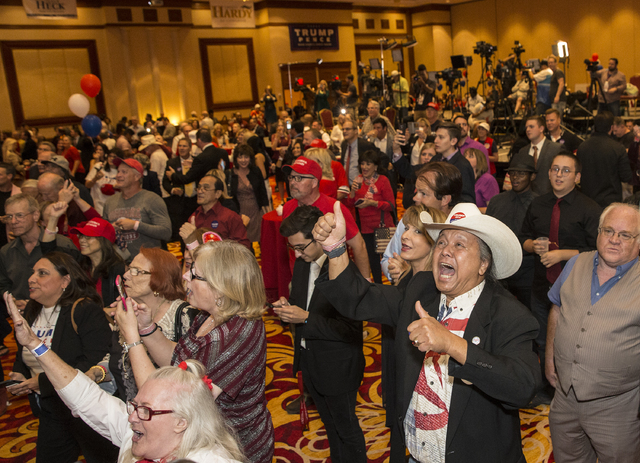 Trump supporter Eddie Hamilton, right, cheers as initial  results are announced at an election night event hosted by the Nevada Republican Party at South Point hotel-casino on Tues, Nov. 8, 2016,  ...