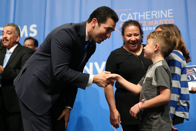 Senator elect Ruben Kihuen, left, shakes the hand of a young supporter during the Nevada State Democratic Party at Aria Hotel-Casino in Las Vegas, Tuesday, Nov. 8, 2016. Erik Verduzco/Las Vegas Re ...