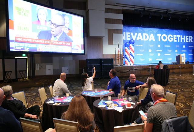 A crowd watches live election results during the Nevada State Democratic Party at Aria Hotel-Casino in Las Vegas, Tuesday, Nov. 8, 2016. Erik Verduzco/Las Vegas Review-Journal Follow @Erik_Verduzco