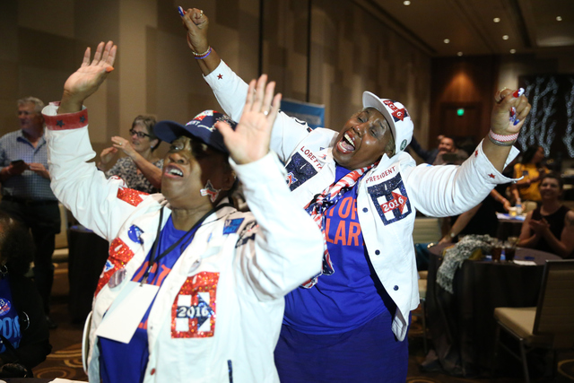 Jennifer Webb-Cook, left, and Loretta Harper, right, react to an election result during the Nevada State Democratic Party at Aria Hotel-Casino in Las Vegas, Tuesday, Nov. 8, 2016. Erik Verduzco/La ...