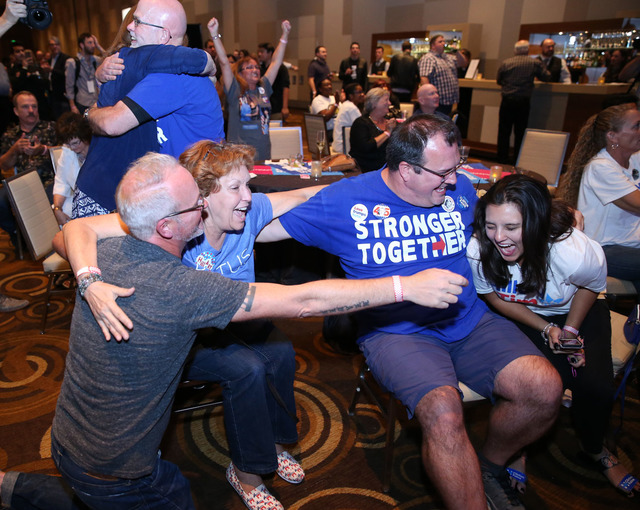 Left to right, Kavin Burkhalter, Donna West, Jim Lovejoy and Lynnette Hull of Las Vegas celebrate an election result during the Nevada State Democratic Party at Aria Hotel-Casino in Las Vegas, Tue ...