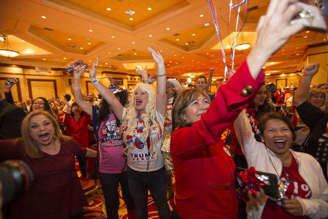 Las Vegas resident Stephanie Smith, center, and others celebrate as Donald Trump is announced President during an election night event hosted by the Nevada Republican Party at South Point hotel-ca ...