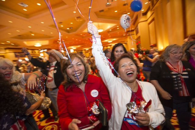 Las Vegas residents Edna White, left, and Jo Devlin react as Donald Trump is announced President during an election night event hosted by the Nevada Republican Party at South Point hotel-casino on ...