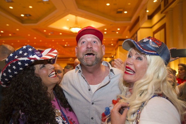 Diana Caldon, from left, Brad Gannon, and Stephanie Smith react as Donald Trump is announced President during an election night event hosted by the Nevada Republican Party at South Point hotel-cas ...