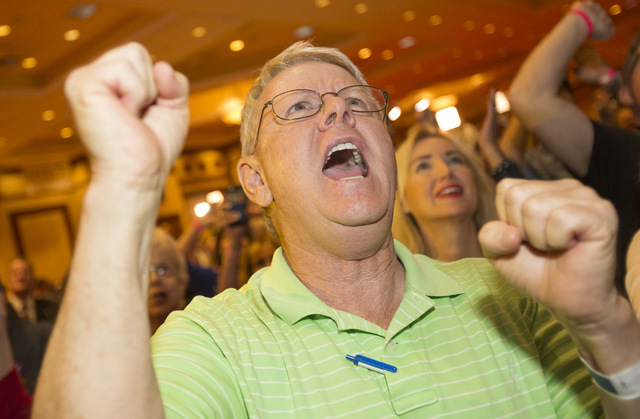 Las Vegas residents Randy Bridges reacts as Donald Trump is announced President during an election night event hosted by the Nevada Republican Party at South Point hotel-casino on Tuesday, Nov. 8, ...
