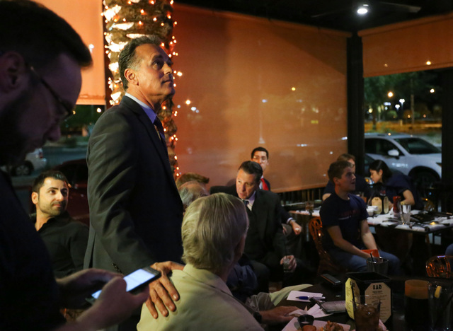 Republican congressional candidate Danny Tarkanian, left, watches election results come in at a watch party at Born and Raised on Tuesday, Nov. 8, 2016. Brett Le Blanc/Las Vegas Review-Journal Fol ...