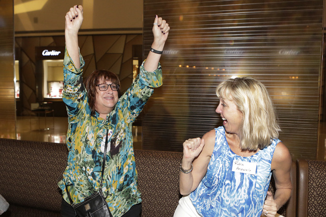 Alice Gordezky, left, and Robin Anawalt, supporters of Yes on 1, the background checks before a gun sale or transfer, react as they watch the presidential election results on television during a w ...