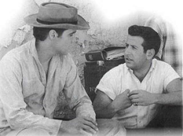 Joe Esposito, a former road manager for Elvis Presley, chats with the King in an undated photo. (Special to View)