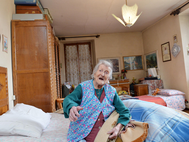 Emma Morano sits on her bed in her apartment in Verbania, Italy, Friday, May 13, 2016. Morano is now the oldest person in the world and is believed to be the last surviving person in the world who ...