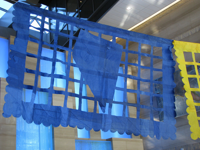 """Justin Favela's installation """"Patrimonio"""" is set to be on display through Dec. 15 at Las Vegas City Hall's Grand Gallery. The paper flags reference holidays including Neva ..."""