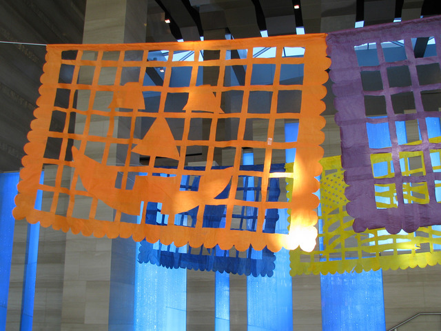 """Justin Favela's installation """"Patrimonio"""" is set to be on display through Dec. 15 at Las Vegas City Hall's Grand Gallery. The paper flags reference holidays including Hall ..."""