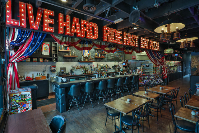 Evel Knievel memorabilia, like a pinball machine and a video game cabinet, fill Evel Pie a pizza restaurant, co-owned by Knievel's son Kelly Knievel and Branden Powers on Fremont Street in Las Veg ...
