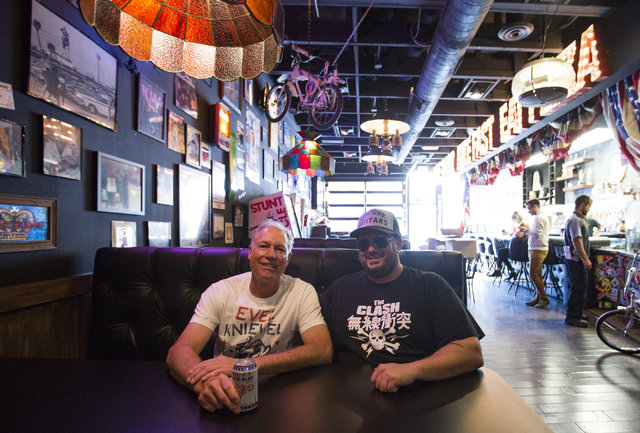Kelly Knievel, the son of Evel Knievel, left, and Branden Powers, co-owners of the Evel Knievel themed restaurant Evel Pie, pose for a photo on Fremont Street in Las Vegas on Tuesday, Nov. 22, 201 ...