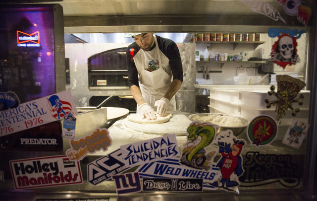 Kit Fitzsimmon, 30, makes a Rattlesnake Pizza, which uses rattlesnake sausage, at Evel Pie on Fremont Street in Las Vegas on Tuesday, Nov. 22, 2016. Brett Le Blanc/Las Vegas Review-Journal Follow  ...