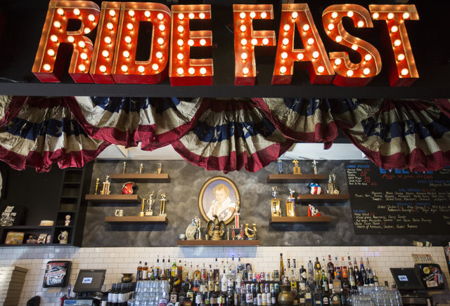 Evel Knievel memorabilia hangs on the walls of Evel Pie, co-owned by Knievel's son Kelly Knievel and Branden Powers on Fremont Street in Las Vegas on Tuesday, Nov. 22, 2016. Brett Le Blanc/Las Veg ...