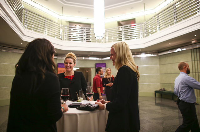 Kandis McClure, co-chair of networking group Fanfare, second from left, talks with people during a group event ahead of a performance at Cabaret Jazz at The Smith Center for the Performing Arts in ...