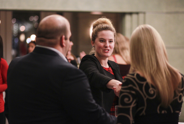 Kandis McClure, co-chair of networking group Fanfare, greets people during a group event ahead of a performance at Cabaret Jazz at The Smith Center for the Performing Arts in Las Vegas on Tuesday, ...