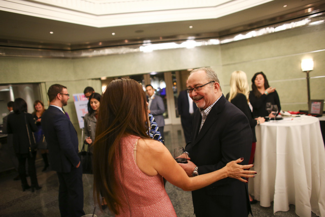 Myron Martin, president and CEO of The Smith Center for the Performing Arts, right, talks with people during a Fanfare networking event ahead of a performance at Cabaret Jazz in Las Vegas on Tuesd ...