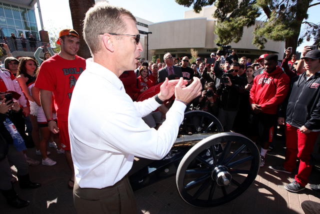 UNLV head football coach Bobby Hauck  claps shortly before painting the Fremont Cannon red in front of the student union on the UNLV campus in Las Vegas on Monday, Oct. 28, 2013.(Justin Yurkanin/L ...