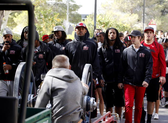 Members of the UNLV football team follow the Fremont Cannon as it makes its way through the UNLV campus in Las Vegas on Monday, Oct. 28, 2013.(Justin Yurkanin/Las Vegas Review-Journal)