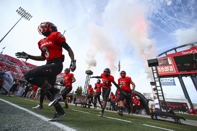 UNLV players enter the field for a football game against Wyoming at Sam Boyd Stadium in Las Vegas on Saturday, Nov. 12, 2016. (Chase Stevens/Las Vegas Review-Journal) Follow @csstevensphoto