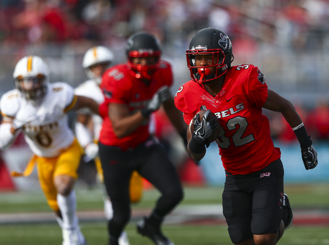 UNLV defensive back Jericho Flowers (32) runs the ball to score a touchdown during a football game against Wyoming at Sam Boyd Stadium in Las Vegas on Saturday, Nov. 12, 2016. (Chase Stevens/Las V ...
