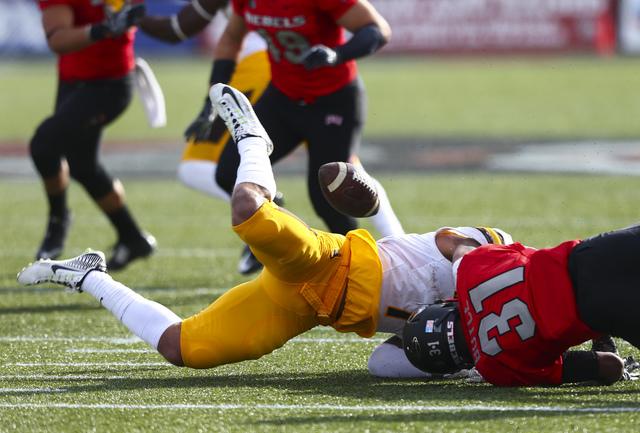 Wyoming linebacker D.J. May (7) fumbles the ball as UNLV defensive back Salah Boyce (31) makes the tackle during a football game at Sam Boyd Stadium in Las Vegas on Saturday, Nov. 12, 2016. UNLV g ...